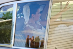 Stefanie arriving for the ceremony - fantastic shot with the reflection of her maids in the window!