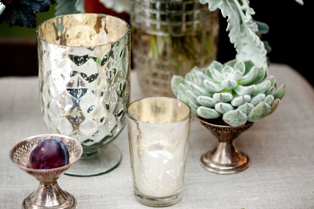 Mercury glass candlelight and vintage silver pieces.