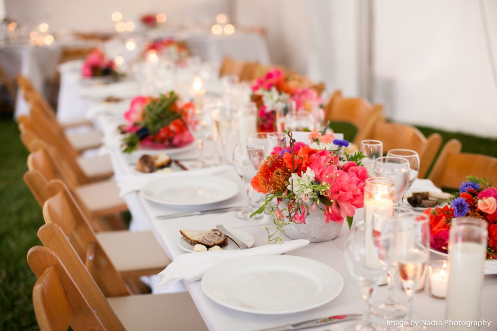 Simple and elegant floral pieces on tables.